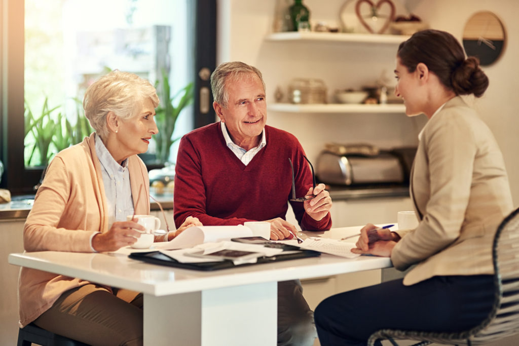 Shot of a senior couple getting advice from their financial consultant