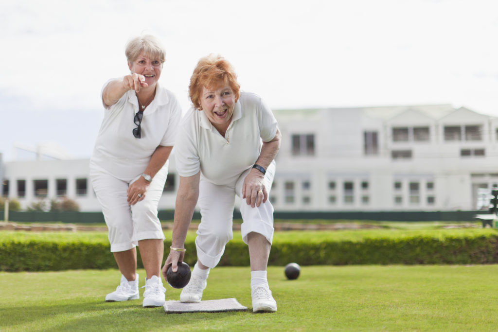 Older women playing lawn bowling
