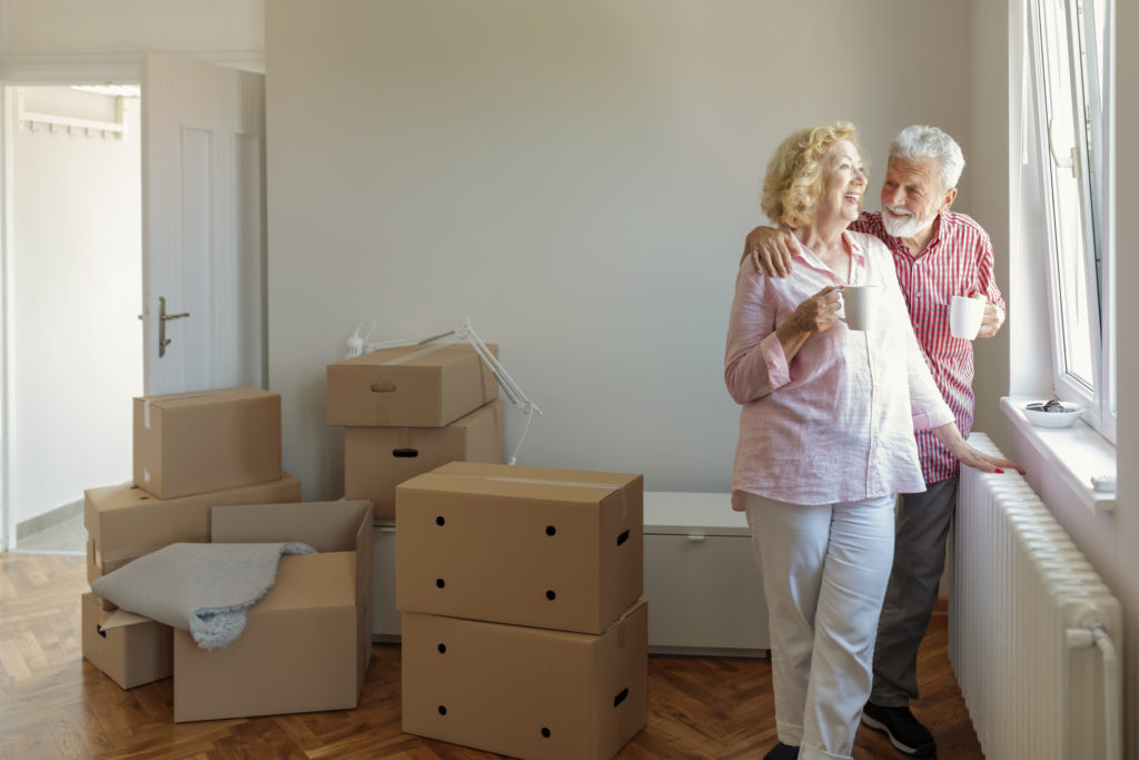 Senior Couple at Moving Day Looking Through the Window