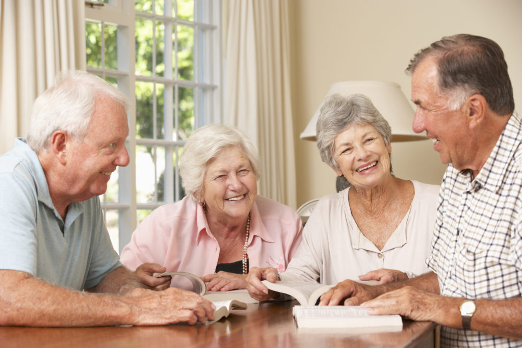 Two Senior Couples Attending Book Reading Group